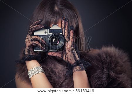 Portrait Of Beautiful Young Retro Woman Holding Vintage Camera