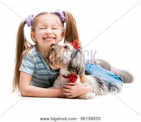 smiling little girl is with her dog Yorkshire Terrier isolated on white backdround