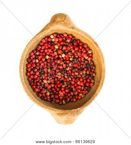 Pink peppercorn isolated on white