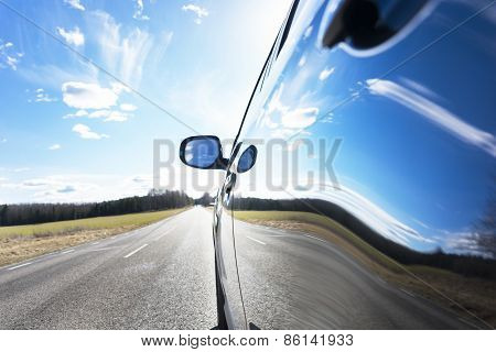 Sky Reflected In Car