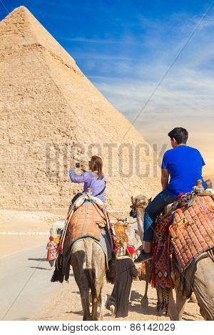 Girl Rides A Camel At Giza Necropolis And Made Photo On Smartphone
