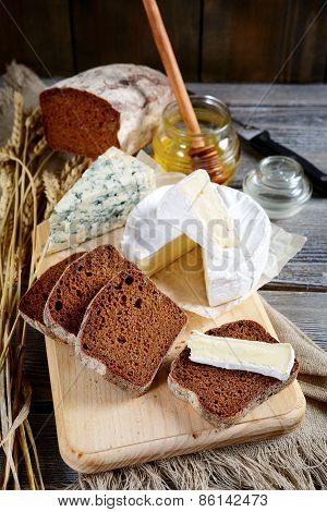 Camembert Cheese, Rye Bread Slices, Roquefort And Honey