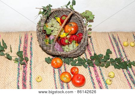Wicker basket with fruits and vegetables.