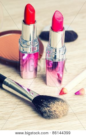 Various Cosmetics On Wooden Table