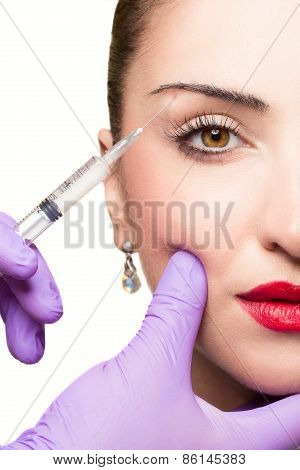 Woman gets cosmetic injection. Beauty Treatment