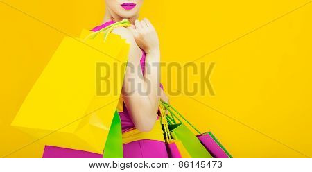 Glamorous Lady With Shopping On Bright Yellow Background