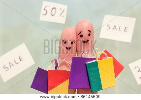 Finger art of a Happy couple with shopping bags