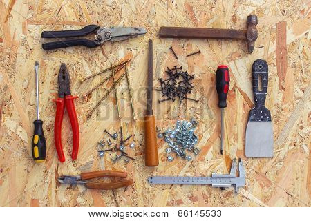 Construction tools on wooden background.