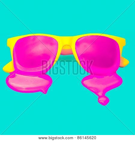Exclusive Yellow Hipster Sunglasses On Blue Background. Dripping Pink Paint. Explosion Summer Colors
