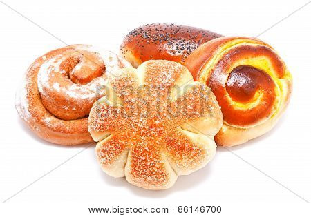 Fresh Sweet Buns And Rolls With Poppy And Cream Isolated