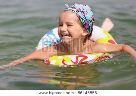 Child Bathing In The Sea