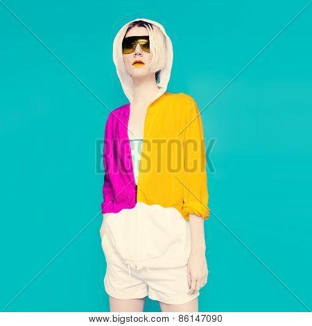 Sportswear Fashion. Glamorous Blonde On Blue Background.