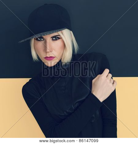 Stylish Blonde In Black Cap And Black Shirt. Latest Fashion Trends