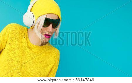 Glamurus Blonde Dj In Bright Clothes Listening To Music On Blue Background