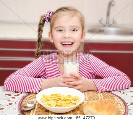 Happy Little Girl Having Breakfast Drinking Milk