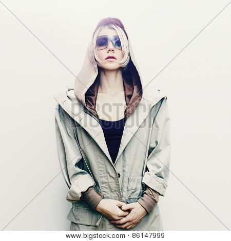 Fashion Blond Girl In Trendy Jeans Cloak. Spring Fashion Accessories. Sunglasses And Glamorous Hood.