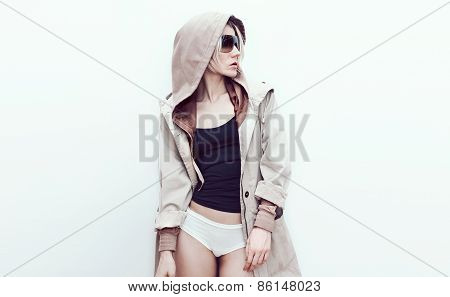 Fashion Model In Trendy Denim Coat. Spring Fashion Accessories. Sunglasses And Glamorous Hood.