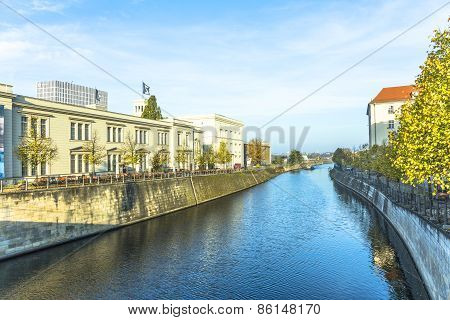 Berlins Buildings And A Boat Shipping At The River
