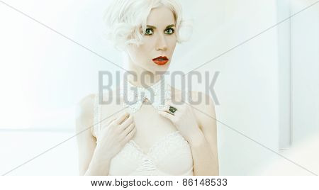 Glamorous Blond Lady. Reflection In The Mirror. Marilyn Monroe Style