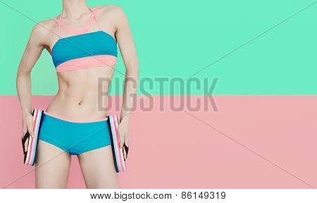 Fitness Girl In Fashionable Sports Swimsuit On Vanilla Background. Swimsuit, Shale, Summer Vacation.