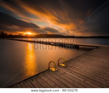 Lake Landscape With Jetty. Long Time Exposure