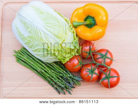 Fresh Vegetables On Wooden Cutting Board
