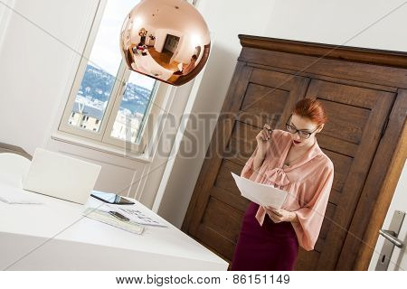 young attractive business woman in office