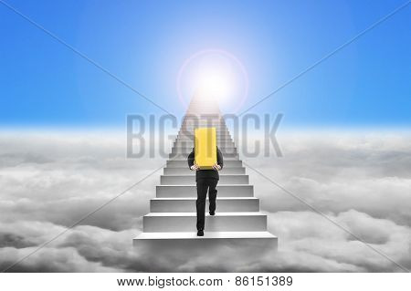 Businessman Carrying Gold Bullion On Stairs With Sky Cloudscape Sunlight