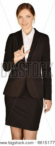 Businesswoman shows forefinger up on white background.