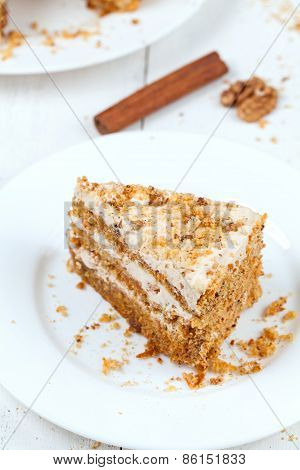 Porttion of handmade sliced carrot cake with cinnamon and walnut