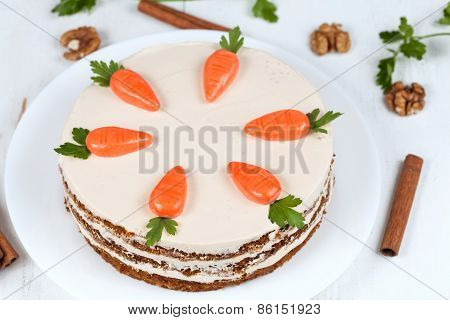 Homemade carrot cake with little carrots on top