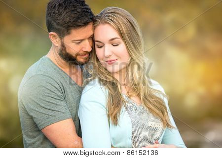 Loving young couple holding each other outside