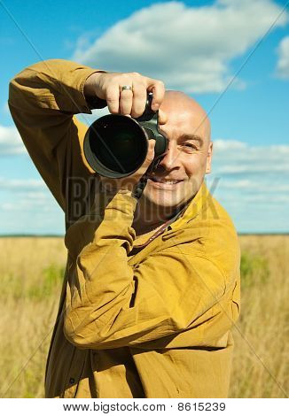 Adult Man Taking Picture