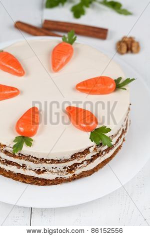 Baked easter carrot cake with icing and little carrots on top