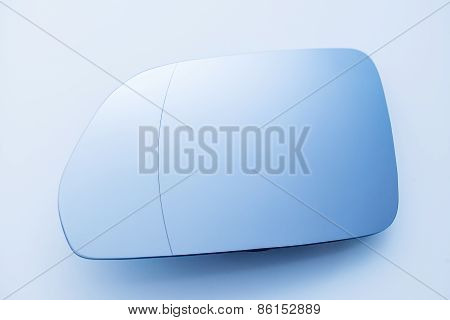 Car Side View Mirror On Clean Blue Background