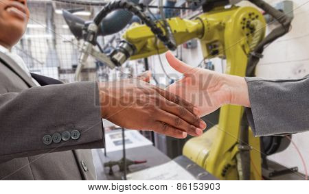 Businessman going shaking a hand against garage