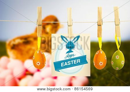 Happy Easter greeting against stuffed chick with easter eggs