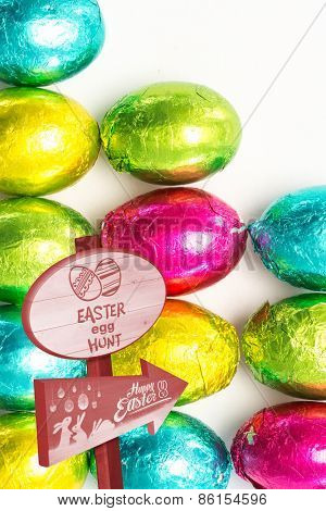Easter egg hunt sign against many easter eggs with copy space