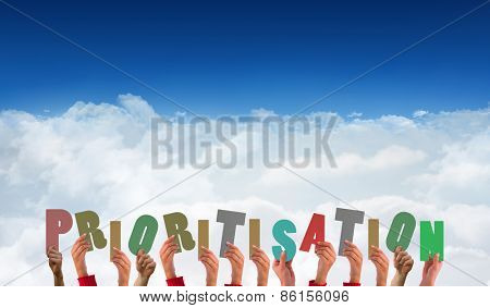 Hands showing prioritisation against bright blue sky over clouds