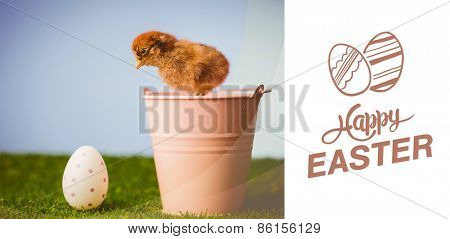 happy easter graphic against stuffed chick in pink bucket