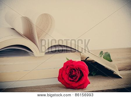 Rose And Heart Of The Book On Wood Background