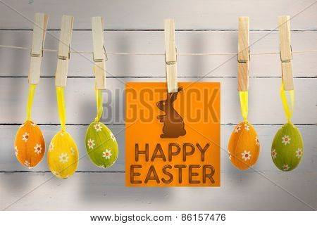 happy easter graphic against painted blue wooden planks