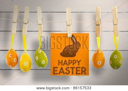 Happy Easter greeting against painted blue wooden planks