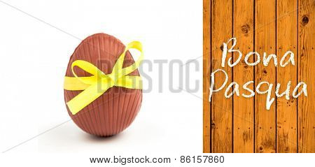 Bona pasqua against wooden planks