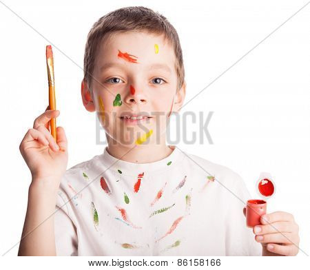 Child with paintbrush. Boy paint isolated on white