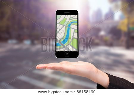 Hand showing map app on phone against blurred new york street