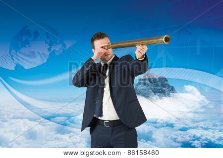 Businessman looking through telescope against global business graphic in blue