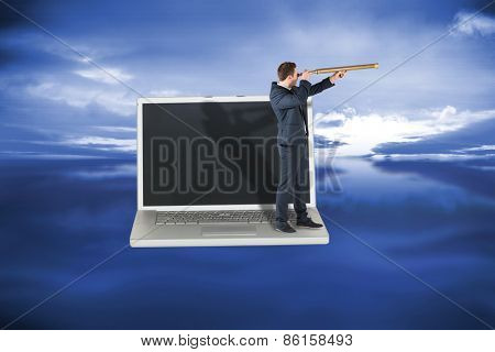 Businessman looking through telescope against blue sky with blue clouds