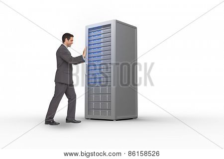 Businessman pushing against server tower