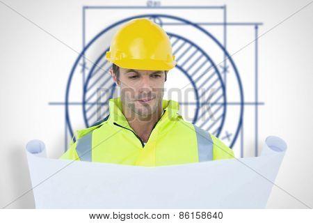 Architect analyzing blueprint against blueprint